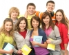A group of young and happy Caucasian teenagers holding notebooks.
